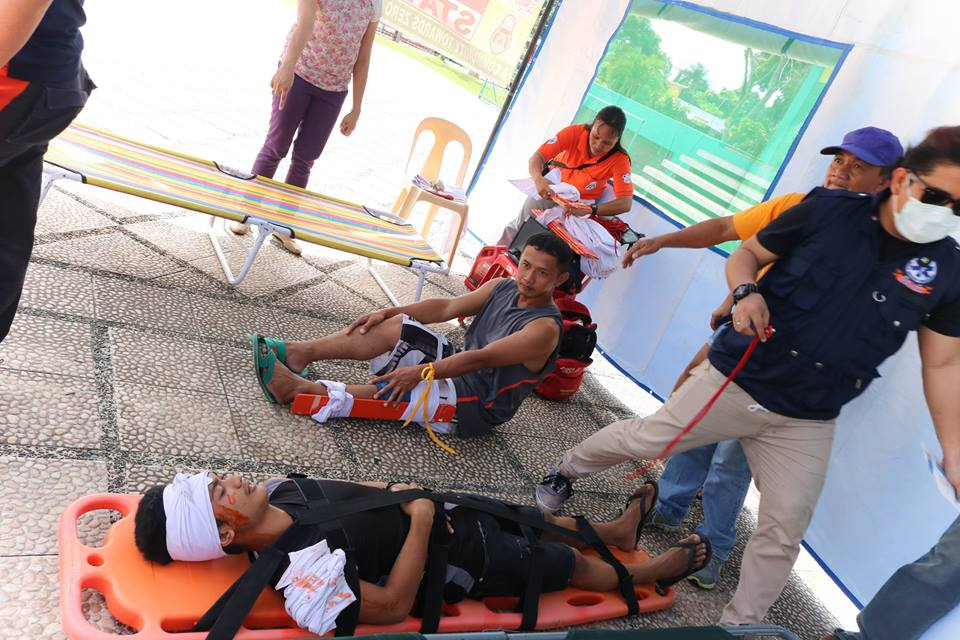 "KIAMBA, Sarangani (October 1, 2016) – Earthquake ""victims"" are rescued during the nationwide simultaneous earthquake drill of the National Disaster Risk Reduction and Management Council on September 28 at the municipal hall. Employees and emergency responders performed the drill in coordination with the Municipal Disaster Risk Reduction and Management Office using the basic earthquake preparation ""duck, cover and hold"". (Rotciv Camposano/KIAMBA INFO CENTER)"